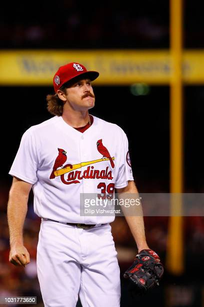 Miles Mikolas of the St Louis Cardinals returns to the dugout after allowing a run against the Pittsburgh Pirates in the fourth inning at Busch...