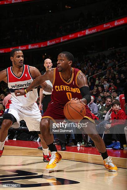 J Miles of the Cleveland Cavaliers drives against Trevor Ariza of the Washington Wizards during the game at the Verizon Center on February 7 2014 in...