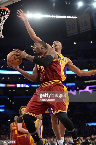 J Miles of the Cleveland Cavaliers goes to the basket against Wesley Johnson of the Los Angeles Lakers at Staples Center on January 14 2014 in Los...