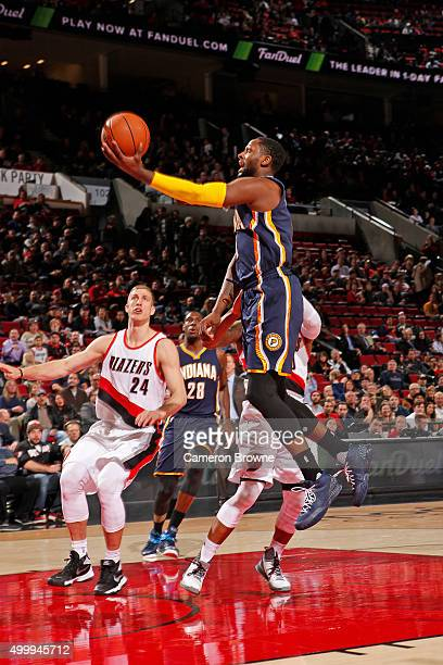 J Miles of the Indiana Pacers drives to the basket against the Portland Trail Blazers on December 3 2015 at the Moda Center Arena in Portland Oregon...