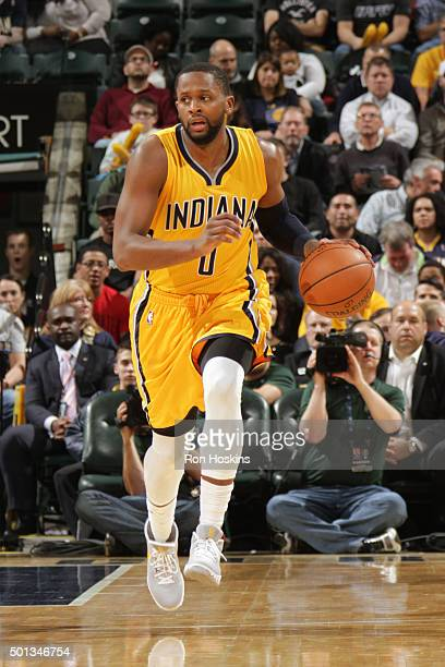 J Miles of the Indiana Pacers handles the ball against the Toronto Raptors on December 14 2015 at Bankers Life Fieldhouse in Indianapolis Indiana...