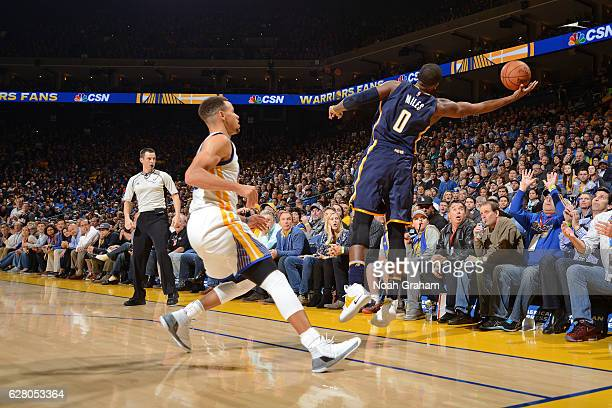J Miles of the Indiana Pacers saves a ball from going out of bounds during the game against the Golden State Warriors on December 5 2016 at ORACLE...