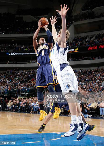 J Miles of the Indiana Pacers shoots a jumper against Dirk Nowitzki of the Dallas Mavericks on November 24 2014 at the American Airlines Center in...