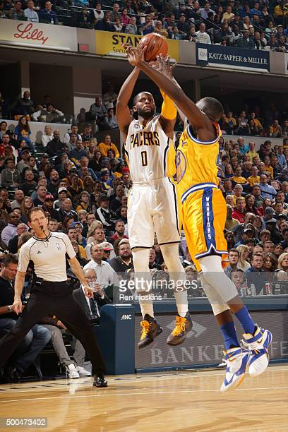 J Miles of the Indiana Pacers shoots against the Golden State Warriors on December 8 2015 at Bankers Life Fieldhouse in Indianapolis Indiana NOTE TO...
