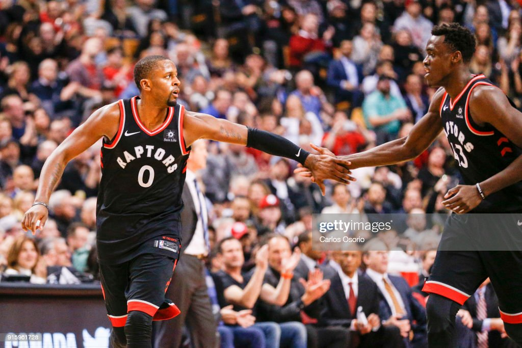 J. Miles (0) of the Raptors celebrates after a basket with Pascal Siakam during the 2nd half of NBA action as the Toronto Raptors host the New York Knicks at the Air Canada Centre on February 8, 2018. The Raptors defeated the Knicks 113-88.