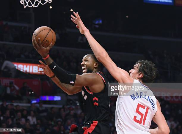Miles of the Toronto Raptors attempts a layup on Boban Marjanovic of the LA Clippers during a 12399 Raptors win at Staples Center on December 11 2018...