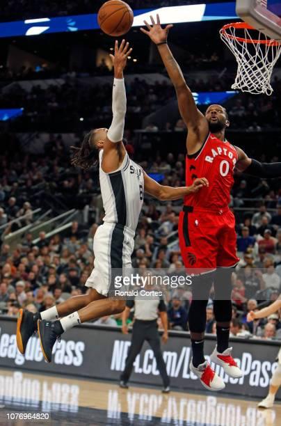 Miles of the Toronto Raptors blocks shot attempt of Patty Mills of the San Antonio Spurs at ATT Center on January 3 2019 in San Antonio Texas NOTE TO...