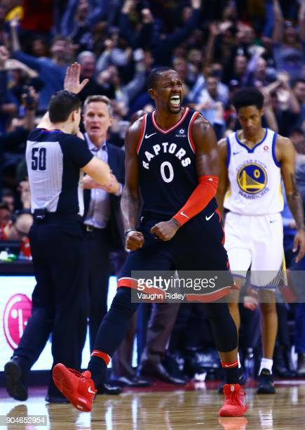 J Miles of the Toronto Raptors celebrates a late basket during the second half of an NBA game against the Golden State Warriors at Air Canada Centre...