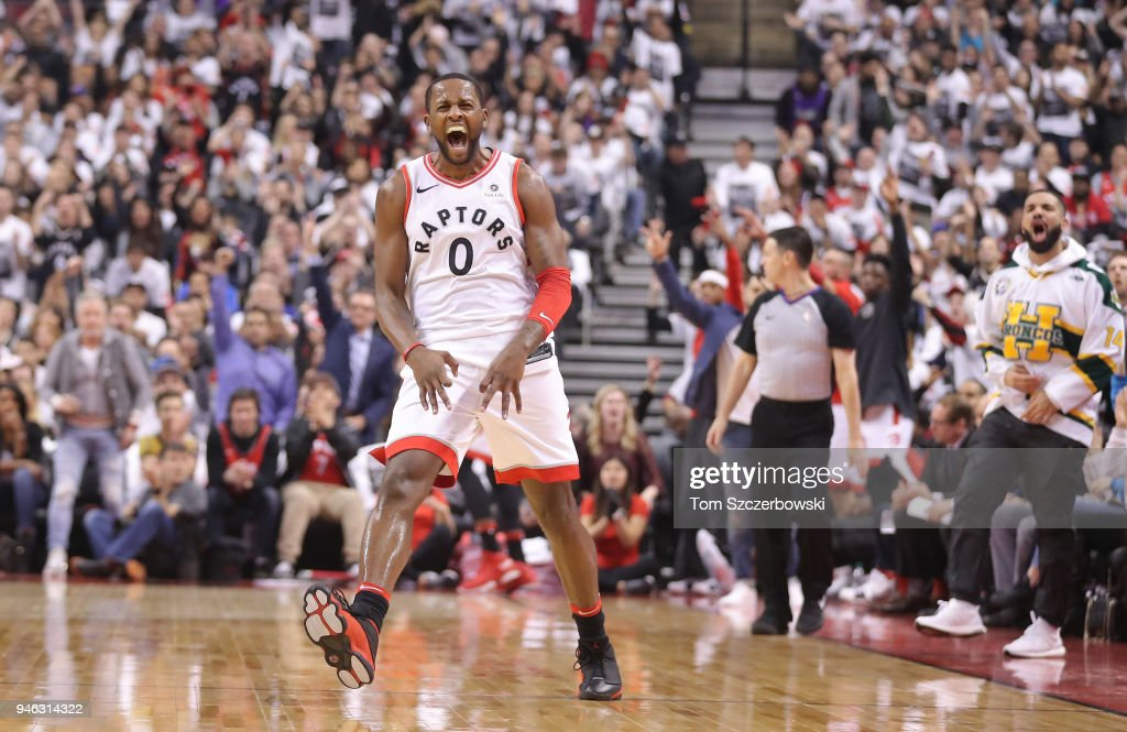 C.J. Miles #0 of the Toronto Raptors celebrates after making a three-pointer as rap artist Drake celebrates on the sideline against the Washington Wizards in the first quarter during Game One of the first round of the 2018 NBA Playoffs at Air Canada Centre on April 14, 2018 in Toronto, Canada.