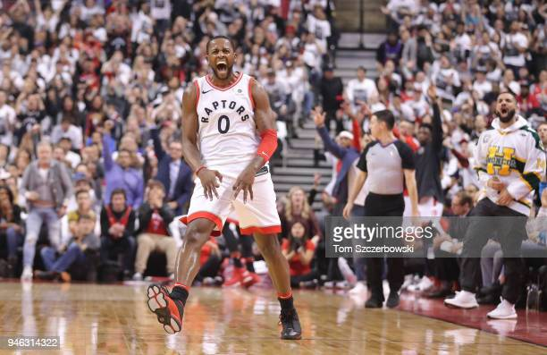 Miles of the Toronto Raptors celebrates after making a three-pointer as rap artist Drake celebrates on the sideline against the Washington Wizards in...