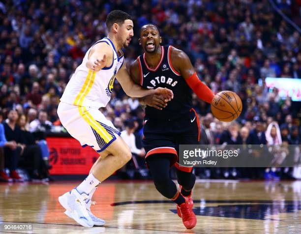 J Miles of the Toronto Raptors dribbles the ball as Klay Thompson of the Golden State Warriors defends during the first half of an NBA game at Air...