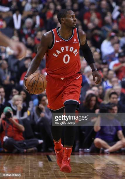 J Miles of the Toronto Raptors dribbles the ball during the second half of the NBA season opener against the Cleveland Cavaliers at Scotiabank Arena...
