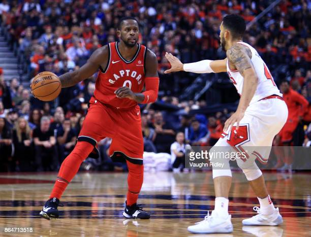 J Miles of the Toronto Raptors dribbles the ball during the second half of an NBA game against the Chicago Bulls at Air Canada Centre on October 19...