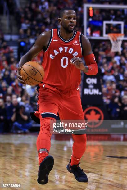 J Miles of the Toronto Raptors dribbles the ball during the second half of an NBA game against the Washington Wizards at Air Canada Centre on...