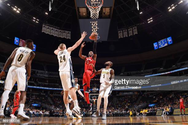 Miles of the Toronto Raptors drives to the basket against the Denver Nuggets on November 1 2017 at the Pepsi Center in Denver Colorado NOTE TO USER...