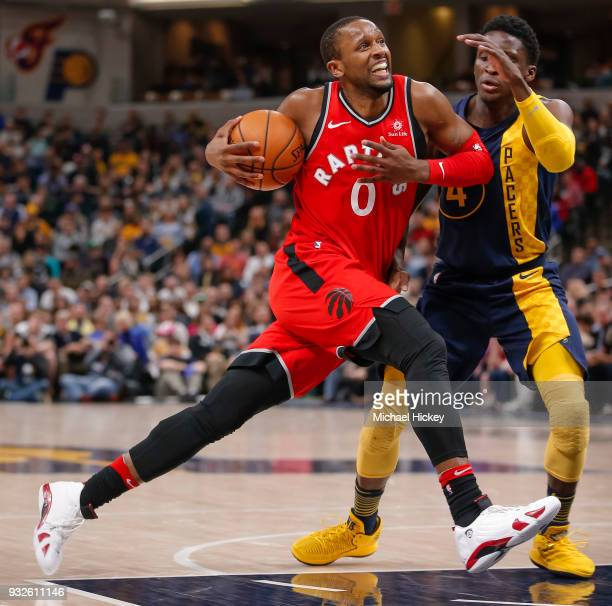 Miles of the Toronto Raptors drives to the basket against Victor Oladipo of the Indiana Pacers at Bankers Life Fieldhouse on March 15 2018 in...