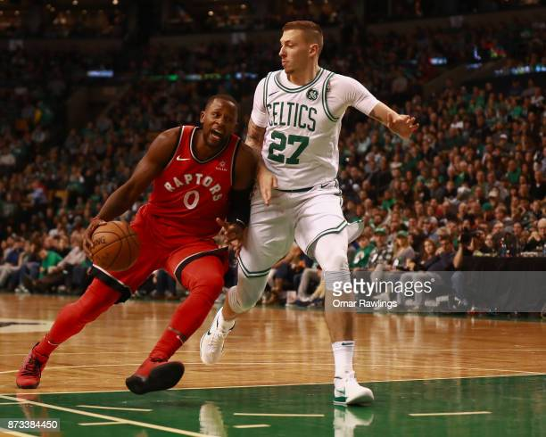 Miles of the Toronto Raptors drives to the basket on Daniel Theis of the Boston Celtics during the third quarter of the game at TD Garden on November...