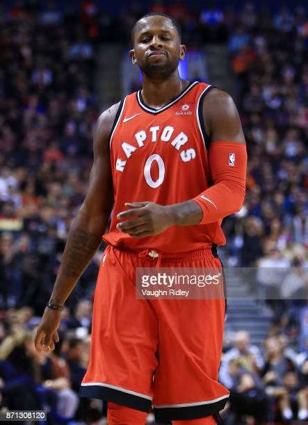 J Miles of the Toronto Raptors reacts after a missed shot during the second half of an NBA game at Air Canada Centre against the Washington Wizards...