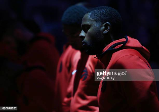 J Miles of the Toronto Raptors stands for the anthems prior to the first half of an NBA game against the Philadelphia 76ers at Air Canada Centre on...