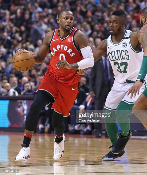 Miles of the Toronto Raptors steps around Semi Ojeleye of the Boston Celtics in an NBA game at the Air Canada Centre on February 6 2018 in Toronto...