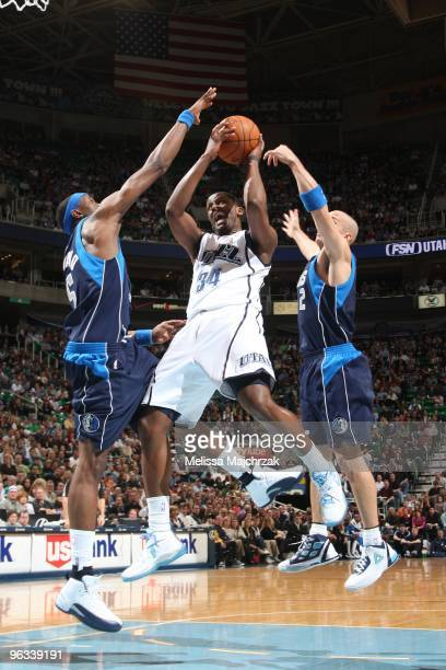 Miles of the Utah Jazz splits the defense of Josh Howard and Jason Kidd # of the Dallas Mavericks and goes up for the shot at EnergySolutions Arena...