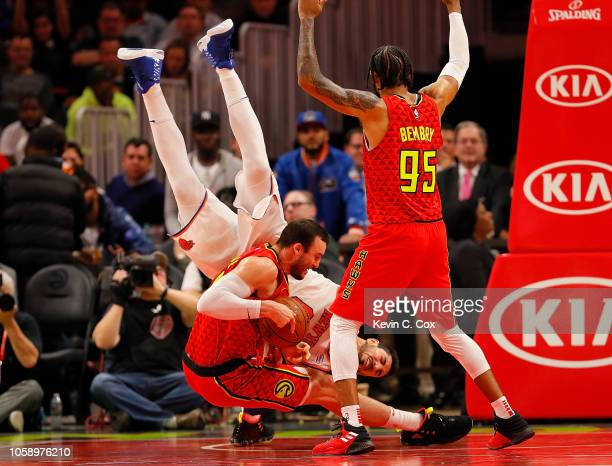 Miles Plumlee of the Atlanta Hawks battles for a rebound against Enes Kanter of the New York Knicks at State Farm Arena on November 7 2018 in Atlanta...