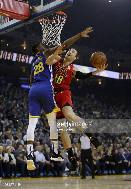 Miles Plumlee of the Atlanta Hawks is fouled by Alfonzo McKinnie of the Golden State Warriors at ORACLE Arena on November 13 2018 in Oakland...