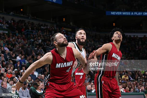 Miles Plumlee of the Milwaukee Bucks fights for position against Josh McRoberts and Gerald Green of the Miami Heat on January 29 2016 at the BMO...