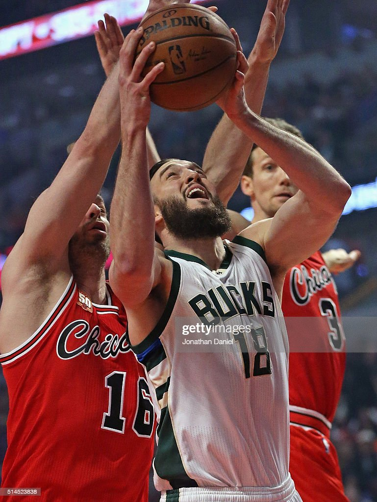 Miles Plumlee #18 of the Milwaukee Bucks goes up for a shot against Pau Gasol #16 and Mike Dunleavy #34 of the Chicago Bulls at the United Center on March 7, 2016 in Chicago, Illinois. The Bulls defeated the Bucks 100-90.