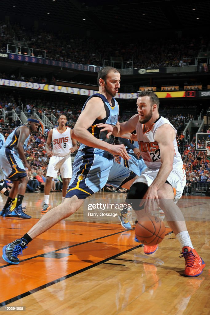 Miles Plumlee #22 of the Pheonix Suns handles the ball against Kosta Koufos #41 of the Memphis Grizzlies on April 14, 2014 at U.S. Airways Center in Phoenix, Arizona.