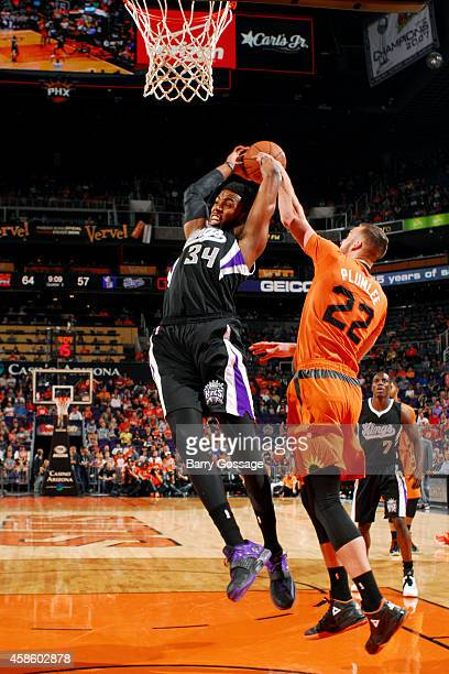 Miles Plumlee of the Phoenix Suns blocks a shot against Jason Thompson of the Sacramento Kings on November 7 2014 at US Airways Center in Phoenix...