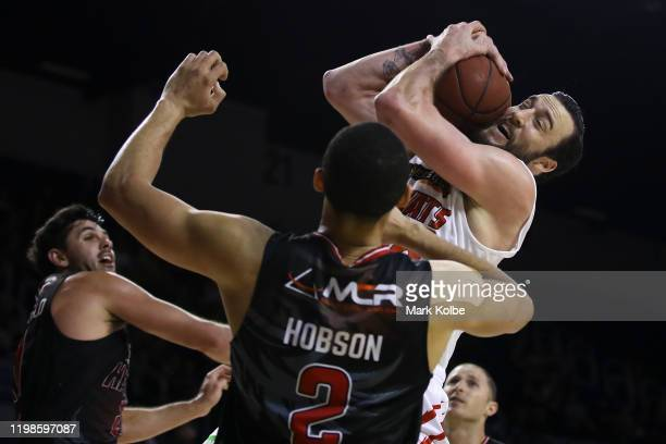 Miles Plumlee of the Wildcats wins the ball during the round 15 NBL match between the Illawarra Hawks and the Perth Wildcats at the WIN Entertainment...