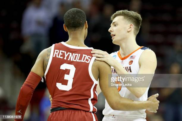Miles Reynolds of the Oklahoma Sooners congratulates Kyle Guy of the Virginia Cavaliers after their second round game of the 2019 NCAA Men's...