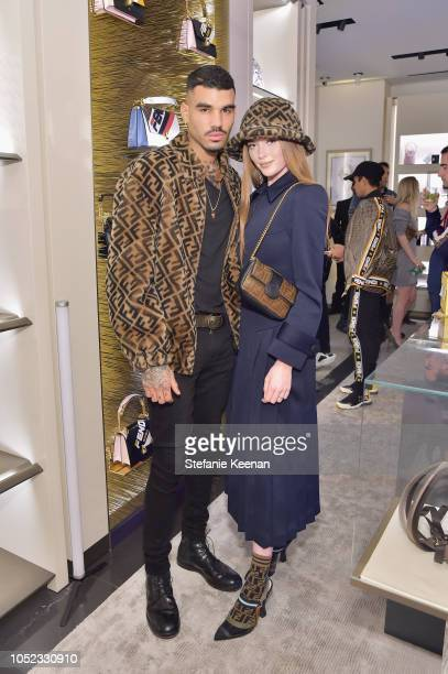Miles Richie and Larsen Thomspon attend the FENDI MANIA Capsule Collection Launch Event at Fendi on October 16, 2018 in Beverly Hills, California.