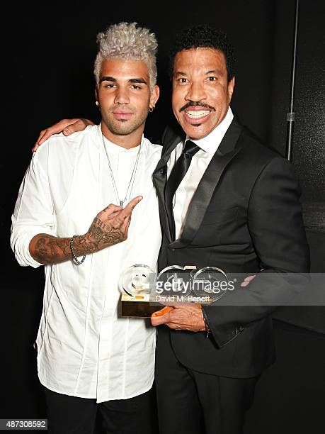 Miles Richie and Lionel Richie attend the GQ Men Of The Year Awards after party at The Royal Opera House on September 8 2015 in London England