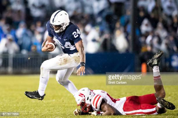 Miles Sanders of the Penn State Nittany Lions carries the ball as he runs past Joshua Kalu of the Nebraska Cornhuskers during the second half on...