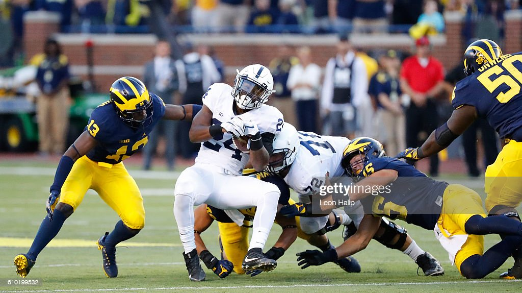 Miles Sanders #24 of the Penn State Nittany Lions drives for a few extra yards during the fourth quarter of the game against the Michigan Wolverines at Michigan Stadium on September 24, 2016 in Ann Arbor, Michigan. Michigan defeated Penn State 49-10.