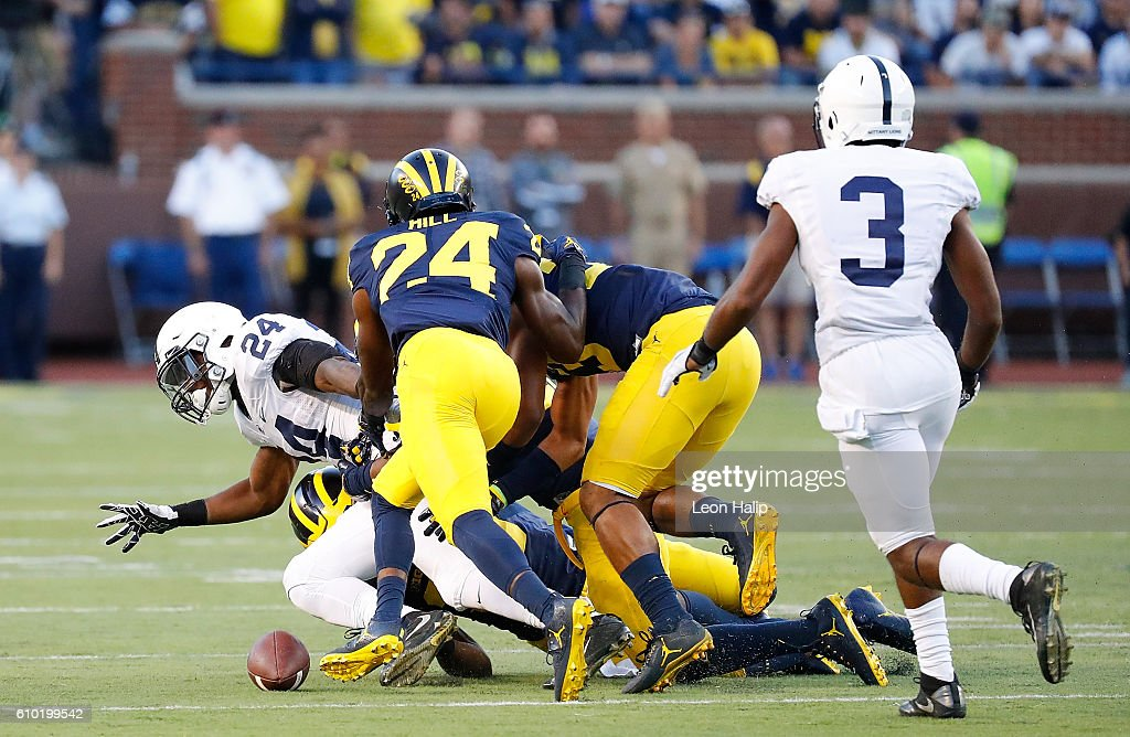 Miles Sanders #24 of the Penn State Nittany Lions fumbles the ball during the fourth quarter of the game against the Michigan Wolverines at Michigan Stadium on September 24, 2016 in Ann Arbor, Michigan. Michigan defeated Penn State 49-10.