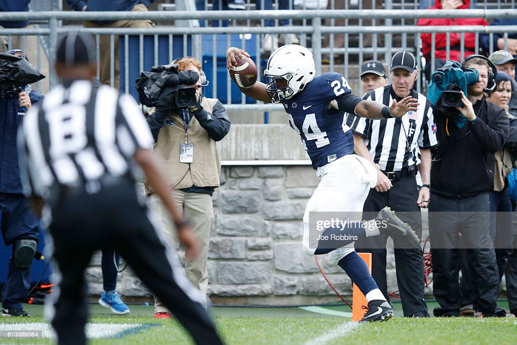 Miles Sanders #24 of the Penn State Nittany Lions runs into the end zone with a 25-yard touchdown against the Maryland Terrapins in the fourth quarter at Beaver Stadium on October 8, 2016 in State College, Pennsylvania. Penn State defeated Maryland 38-14.