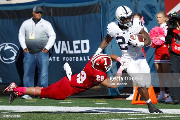 Miles Sanders of the Penn State Nittany Lions runs the ball against Khalil Bryant of the Indiana Hoosiers in the first quarter of the game at...
