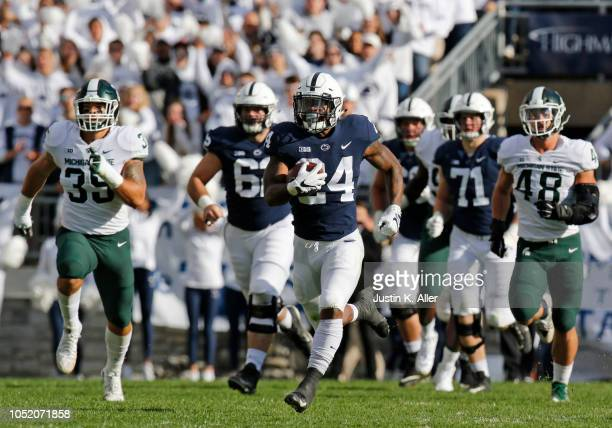 Miles Sanders of the Penn State Nittany Lions rushes for 78 yards against Joe Bachie of the Michigan State Spartans and Kenny Willekes of the...
