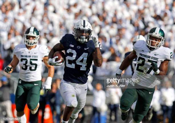 Miles Sanders of the Penn State Nittany Lions rushes for 78 yards against Joe Bachie of the Michigan State Spartans and Khari Willis of the Michigan...