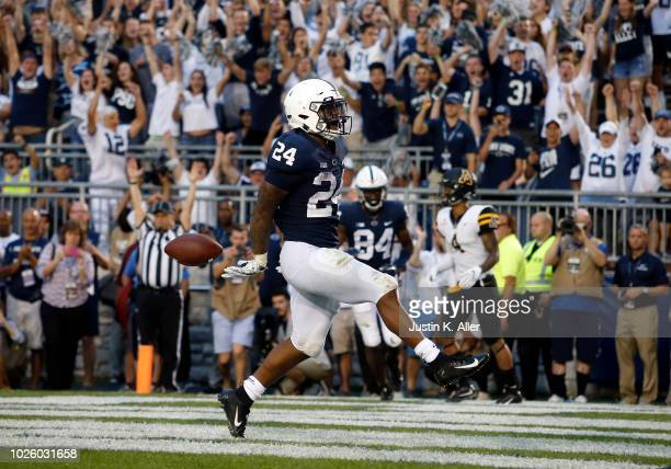 Miles Sanders of the Penn State Nittany Lions rushes for a 4 yard touchdown in overtime against the Appalachian State Mountaineers on September 1...