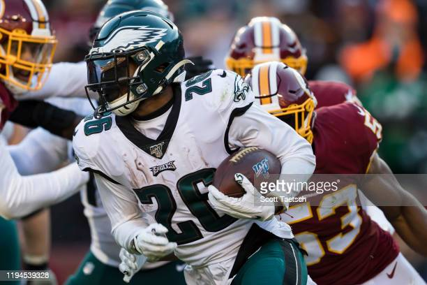 Miles Sanders of the Philadelphia Eagles carries the ball against the Washington Redskins during the second half at FedExField on December 15 2019 in...