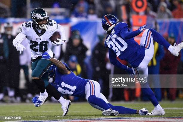 Miles Sanders of the Philadelphia Eagles carries the ball during the first half of the game against the New York Giants at MetLife Stadium on...