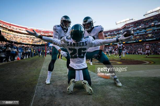 Miles Sanders of the Philadelphia Eagles celebrates with J.J. Arcega-Whiteside and Dallas Goedert after catching a pass for a touchdown against the...