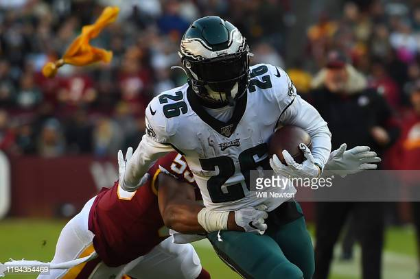 Miles Sanders of the Philadelphia Eagles is tackled by Jon Bostic of the Washington Redskins during the first half at FedExField on December 15 2019...