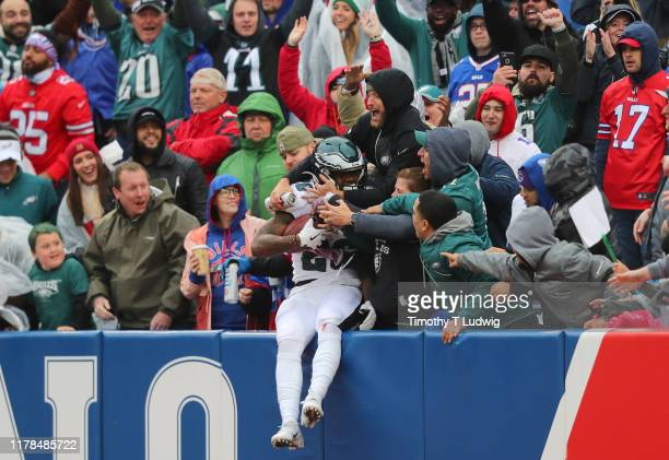 Miles Sanders of the Philadelphia Eagles jumps into the crowd to celebrate his touchdown during the second half against the Buffalo Bills at New Era...