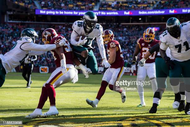 Miles Sanders of the Philadelphia Eagles leaps into the end zone to score a touchdown against the Washington Redskins during the first half at...