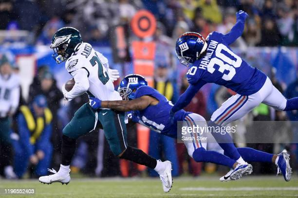 Miles Sanders of the Philadelphia Eagles runs the ball against the New York Giants during the first quarter in the game at MetLife Stadium on...